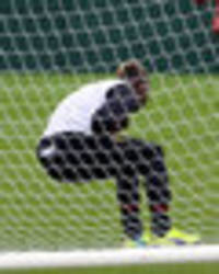 SNAPPED: Mario Balotelli in agony after shot hits him in BALLS during Liverpool training